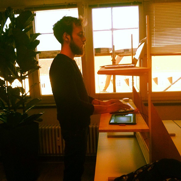 Roel is working at a make-shift standing desk at SoundCloud
